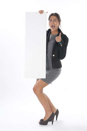account executives: Thumb up young business woman, holding sign on white background. Stock Photo