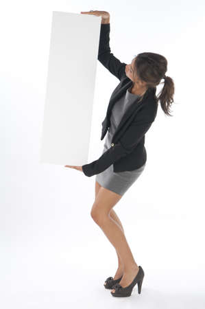 Young business woman, holding sign on white background. photo