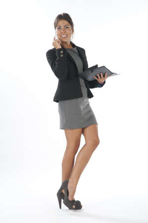 account executives: Young business executive female, on white, talking on the phone, looking at camera.