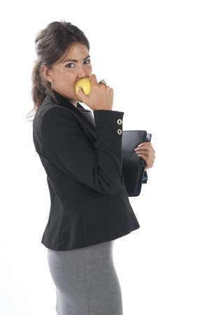 account executive: Waist up, young business executive woman, on white, biting an apple.