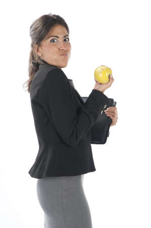 account executives: Waist up, healthy young business executive woman, on white, eating an apple.