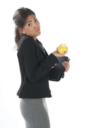 Waist up, healthy young business executive woman, on white, eating an apple. Stock Photo - 14429778