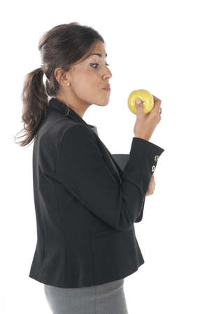 Waist up, healthy young business executive woman, on white, eating an apple. Stock Photo - 14429808
