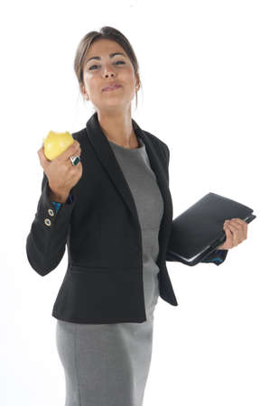 Waist up, healthy young business executive woman, on white, eating an apple. Stock Photo - 14429784
