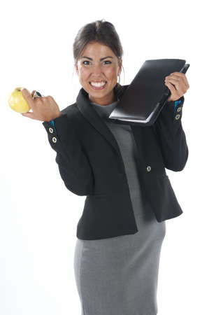 Waist up, healthy young business executive woman, on white, eating an apple. Stock Photo - 14429864