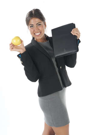 Waist up, healthy young business executive woman, on white, eating an apple. Stock Photo - 14429757