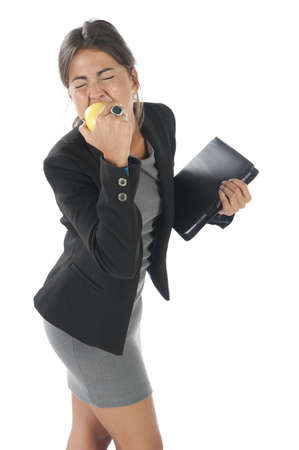 Waist up, healthy young business executive woman, on white, eating an apple.