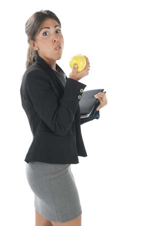 Waist up, healthy young business executive woman, on white, eating an apple. Stock Photo - 14429748