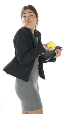 Waist up, healthy young business executive woman, on white, eating an apple. Stock Photo - 14429758