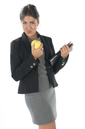 Waist up, healthy young business executive woman, on white, eating an apple. Stock Photo - 14429761