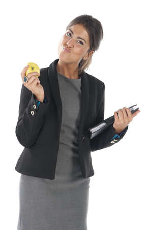 Waist up, healthy young business executive woman, on white, eating an apple. Stock Photo - 14429851