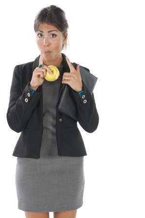 Waist up, healthy young business executive woman, on white, eating an apple. Stock Photo - 14429789