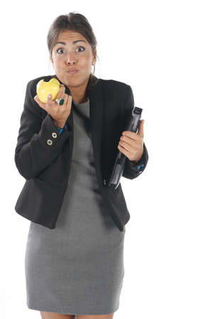 account executive: Waist up, healthy young business executive woman, on white, eating an apple.