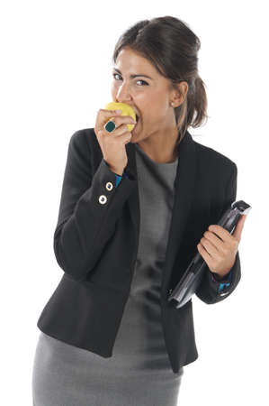 spaniard: Waist up, healthy young business executive woman, on white, eating an apple.