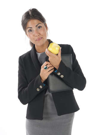 Waist up, healthy young business executive woman, on white, eating an apple. Stock Photo - 14429868