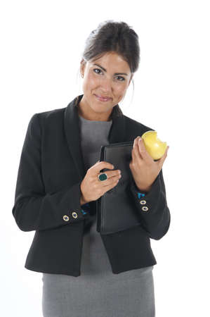 Waist up, healthy young business executive woman, on white, eating an apple. Stock Photo - 14429869