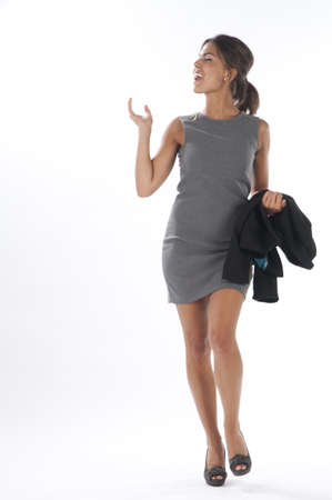 gesticulating: Young business executive woman, on white, walking towards camera. Stock Photo