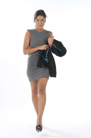 Full length Self confident young business executive woman, on white, walking towards camera. photo