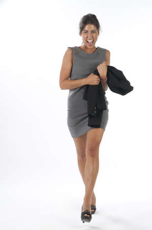 Full length happy and laughing young business executive woman, on white, walking towards camera. Stock Photo