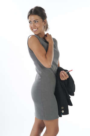Happy young business executive woman, looking back with loly pop.