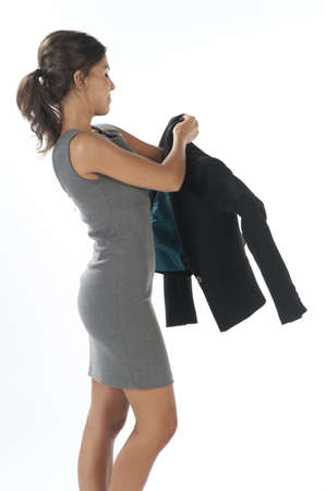 formal dressing: Young business executive woman, on white getting dressed.