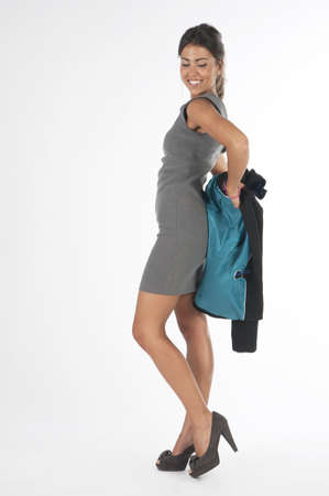 Young and elegant executive, taking off hes jacket Stock Photo - 14429765
