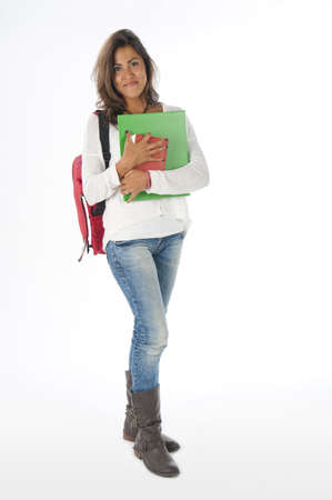 Young girl student, on white, wearing jeans and t-shirt, holding notebooks. Stock Photo - 14590929