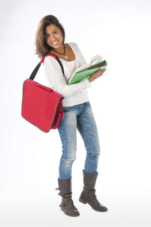 Young self-confident girl student, on white, wearing jeans and t-shirt, holding notebooks.