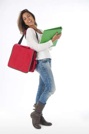 Full size portrait of happy young girl student, on white, wearing jeans and t-shirt, holding notebooks. Stock Photo - 14584778