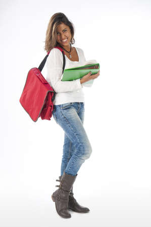 Full size portrait of happy young girl student, on white, wearing jeans and t-shirt, holding notebooks. Stock Photo - 14591142