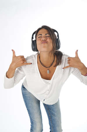Three quarter length portrait of young girl with casual clothing, on white,  enjoying music gesturing