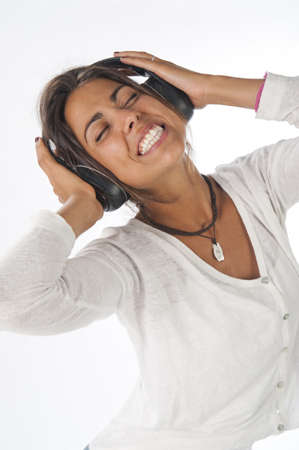 Close-up portrait of happy young female adult with headphones, enjoying listening to music.