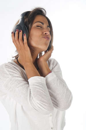 Close-up portrait of happy young female adult with headphones, enjoying feeling the music. Stock Photo