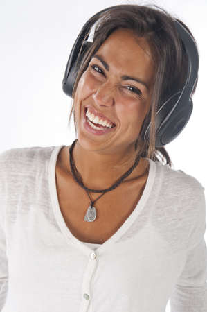 Close-up portrait of happy young female adult with headphones, enjoying listening to music. photo
