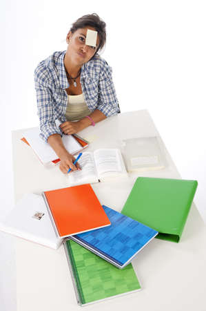 High Angle view of young female tired student in front of table with books and notebooks  Stock Photo - 14938086