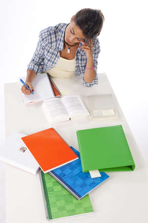 High Angle view of serious and concentrated girl studying on table with books and notebooks Stock Photo - 14938090