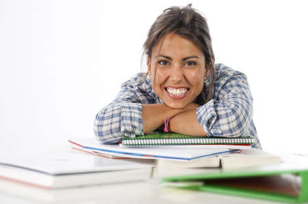 Proud, self-confident portrait of happy big smile young female student with books and notebooks on table.