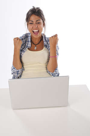 Cheerful girl in front of Laptop with hands up. Stock Photo - 14591114