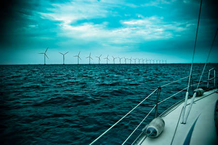 raw of windmills shot from yacht, denmark, oresund, baltic sea