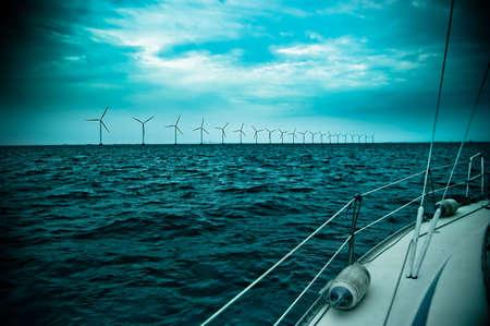 raw of windmills shot from yacht, denmark, oresund, baltic sea