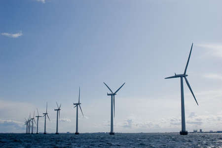 Windmills in a row with clear sky , oresund, denmark, baltic sea