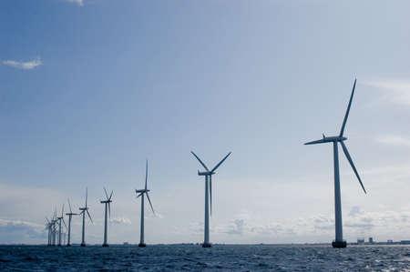 Windmills in a row with clear sky , oresund, denmark, baltic sea