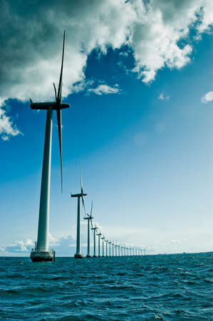 wind farm: Windmills in a row vertical, denmark, oresund, baltic sea Stock Photo