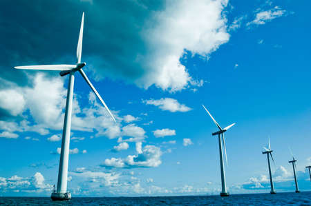 offshore: Row of windmills closer, horizontal, denmark, baltic sea  Stock Photo