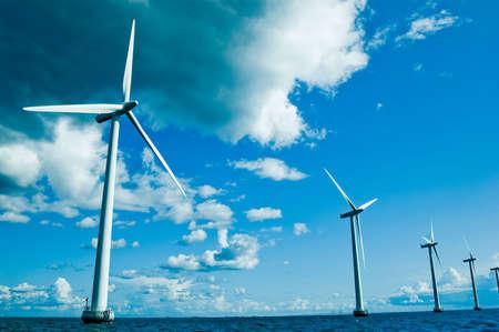 power lines: Row of windmills closer, horizontal, denmark, baltic sea  Stock Photo