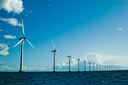 wind turbine: Windmills in a row further, horizontal, wide shot, denmark Stock Photo