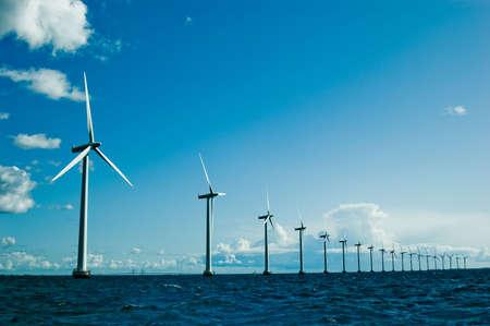 wind turbines: Windmills in a row further, horizontal, wide shot, denmark Stock Photo