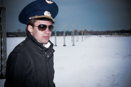young pilot with glasses and black coat on the landing line