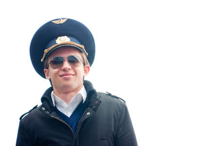 smiling young pilot isolated with copyspace against white, low angle Stock Photo