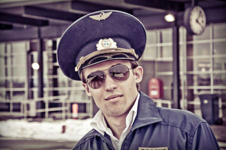 portrait young student pilot outside the airport, creative color